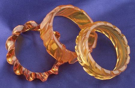 Three Bakelite Carved Apple Juice Bangles