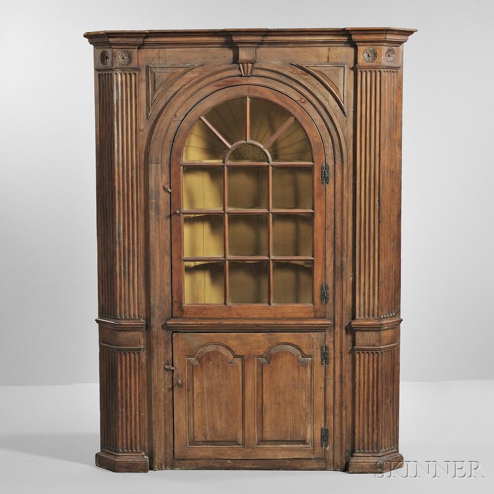 Glazed Carved Pine Barrel-back Corner Cupboard