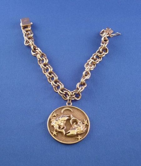14kt Gold Link Bracelet and 14kt Gold Pisces Charm.