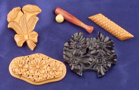Five Bakelite Carved Brooches