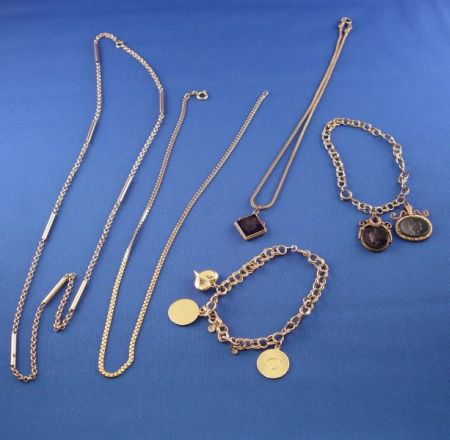 14kt and a 18kt Gold Chain and 14kt Gold Charm Bracelet and Three Intaglio Charms