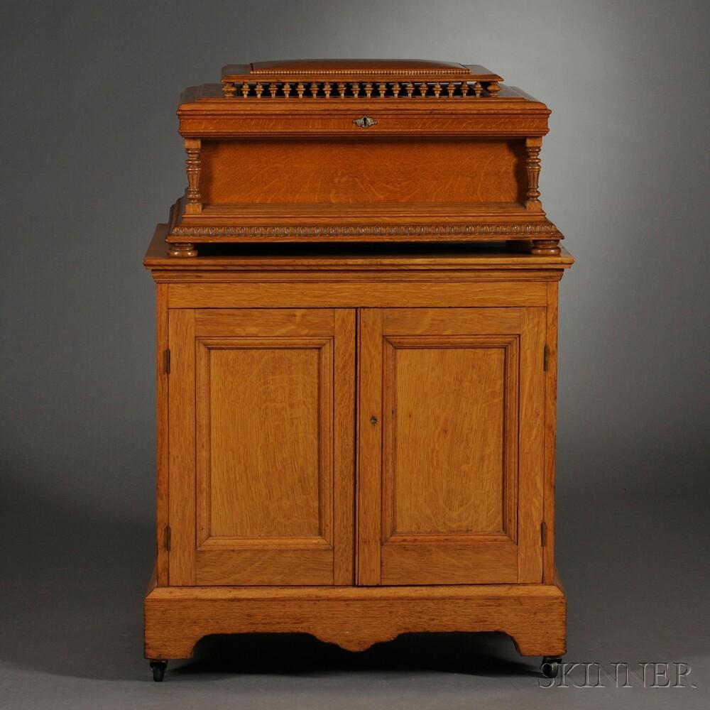Regina 20 3/4-inch Disc Oak Musical Box and Cabinet