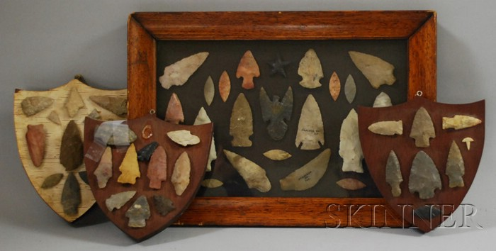 Four Native American Arrowhead Mounted in Display Cases.