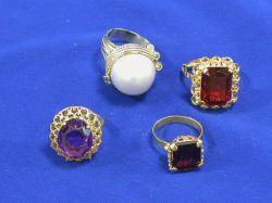 Mabe Pearl Ring and Three Gem-set Rings.