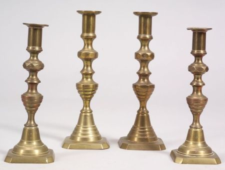 Two Pairs of Brass Push-up Candlesticks