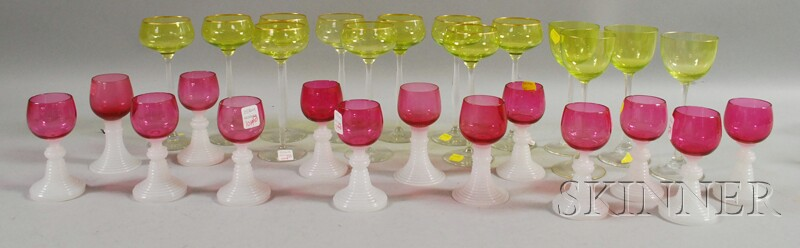 Set of Fourteen Cranberry and Clambroth Glass Wines, and Two Sets of Gilt   Vaseline and Colorless Glass Wine/Cocktail Stems