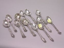 Six Sterling Teaspoons and Six Plated Tea and Serving Spoons.