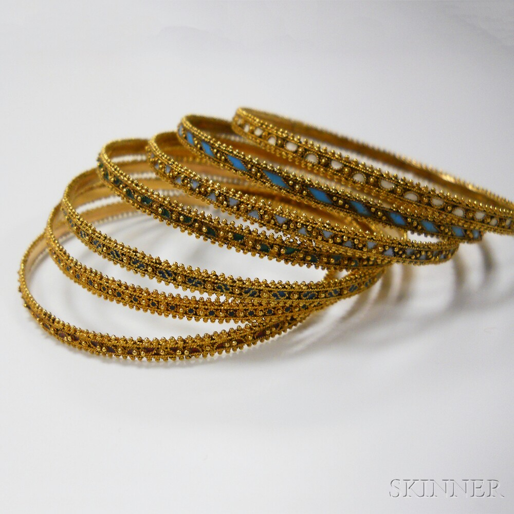 Group of Seven .800 Gold and Enamel Bangles