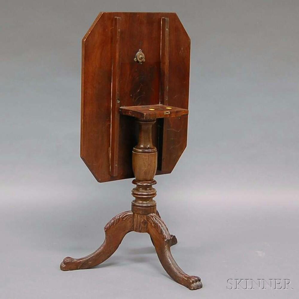Empire Carved Mahogany Tilt-top Tea Table.     Estimate $200-300