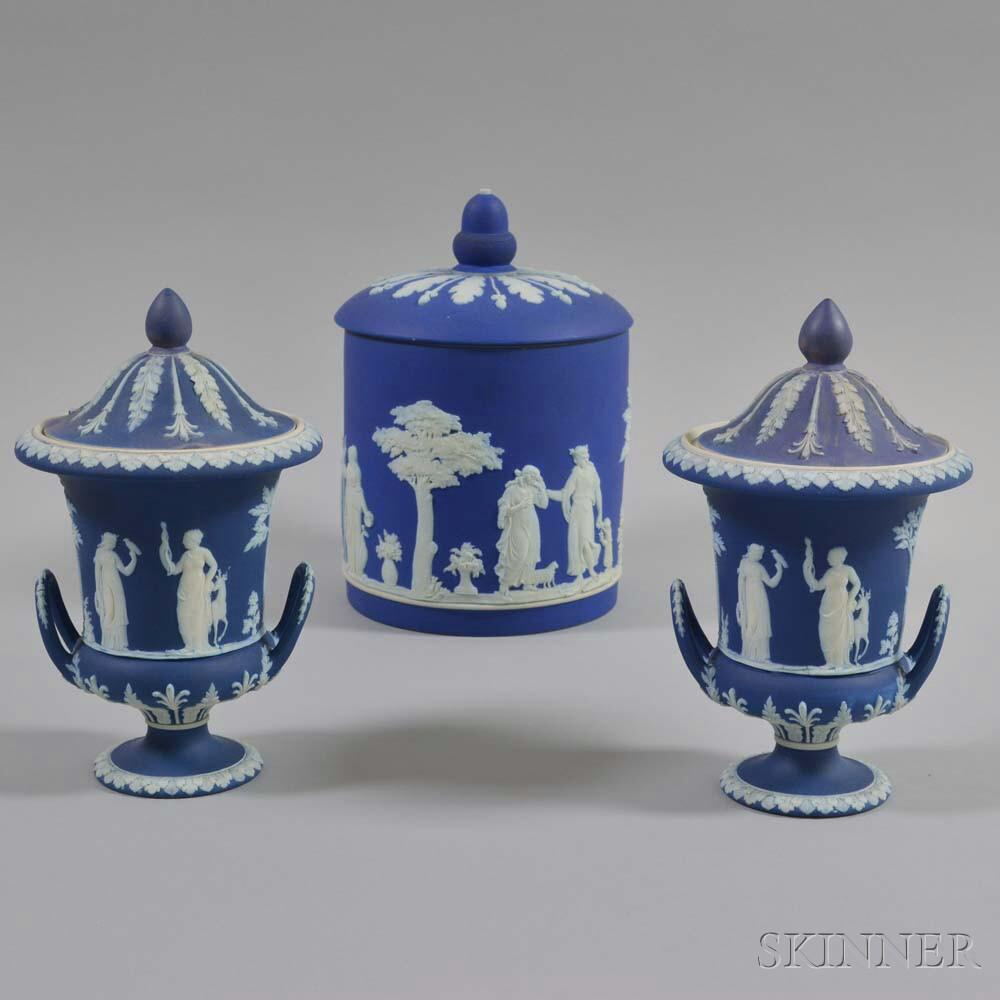 Wedgwood Dark Blue Jasper Covered Jar and a Pair of Covered Urns
