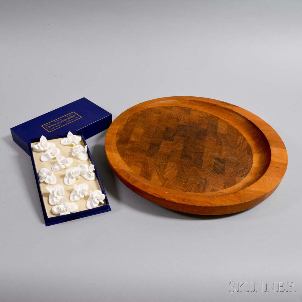 Dansk Wood Cutting Board and a Set of Twelve Crown Staffordshire Place Card Holders.     Estimate $20-200