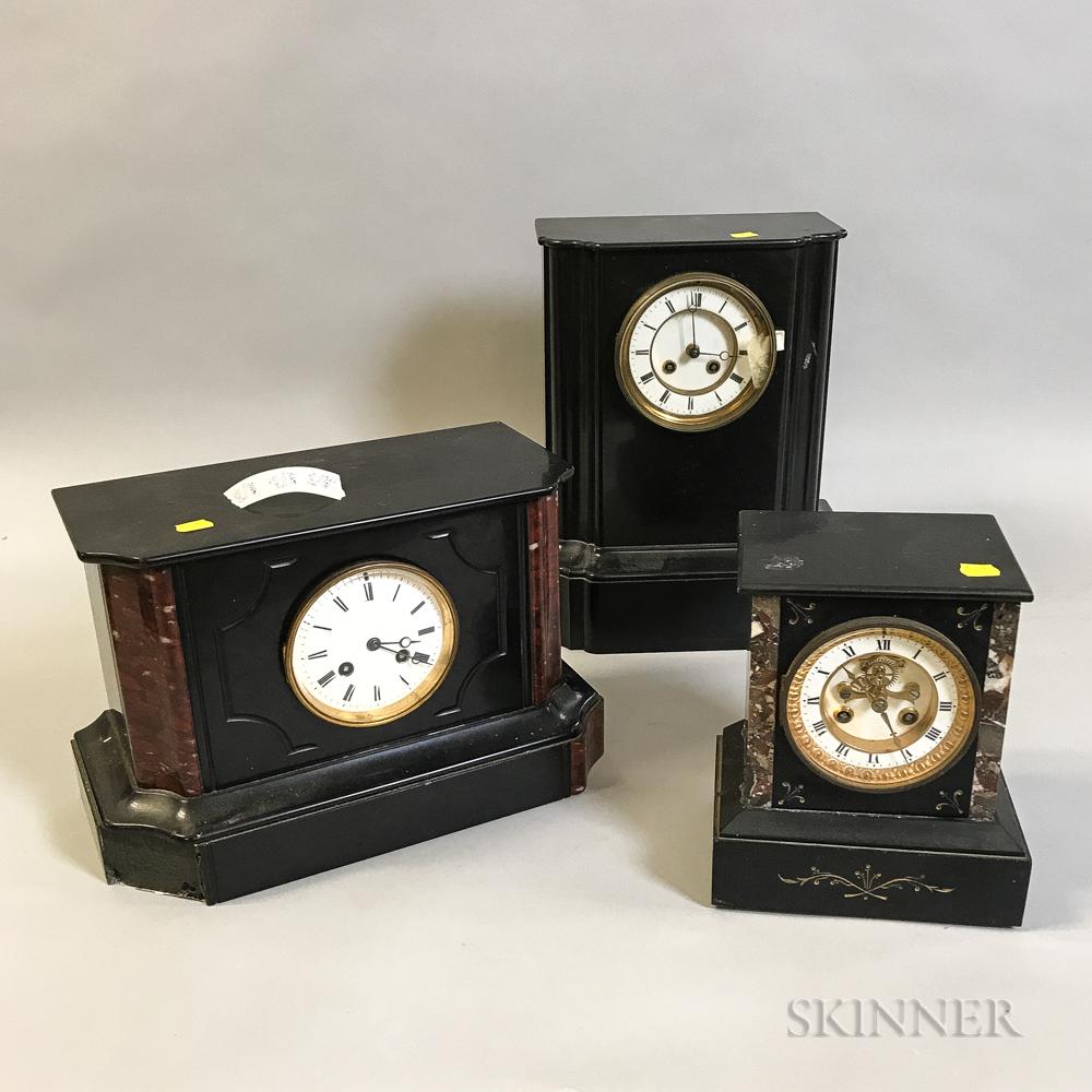 Three Empire-style Black Marble Mantel Clocks