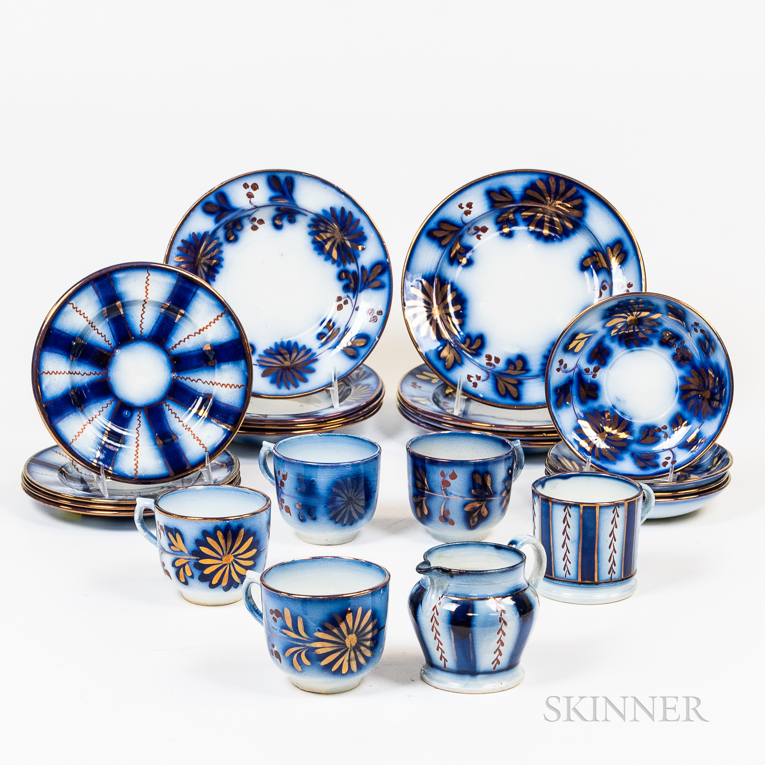 Group of Flow Blue Tableware with Copper Lustre Details