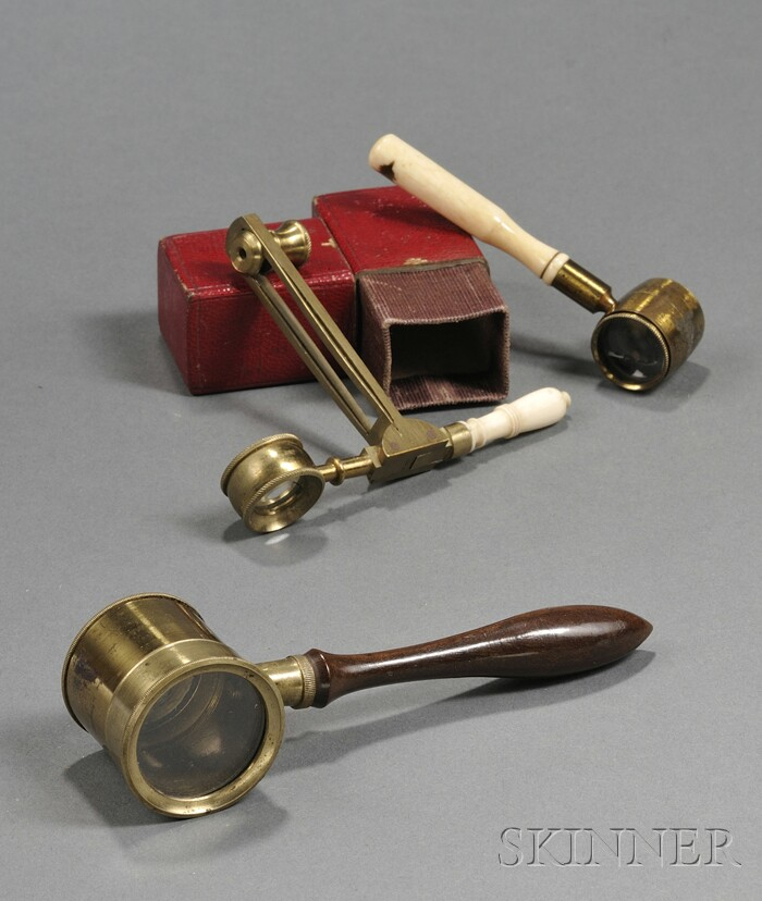 Three Handheld Microscopes