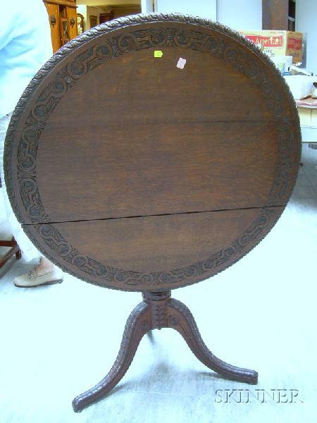Victorian Carved Oak Tilt-top Tea Table.