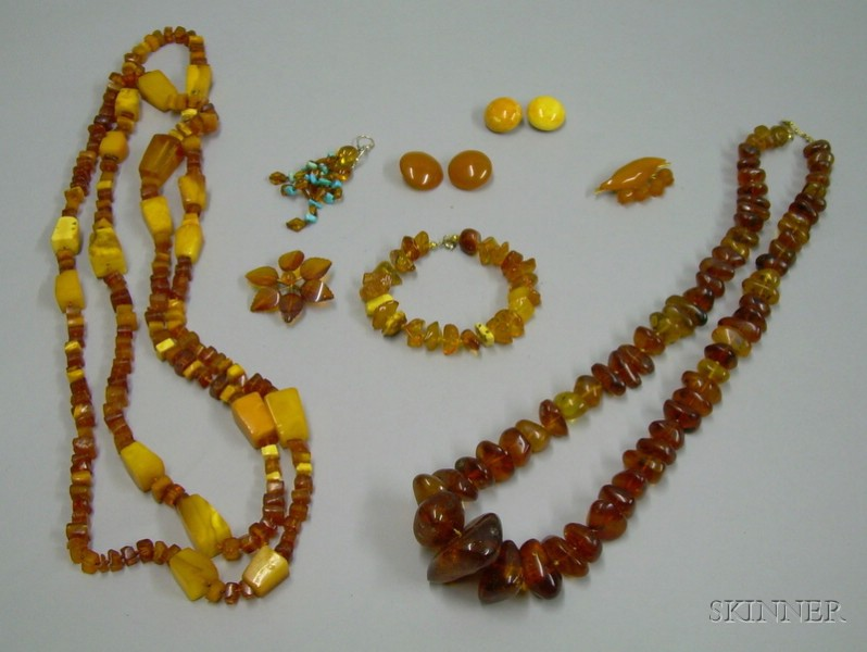 Two Amber Bead Necklaces, Three Pairs of Amber Earrings, an Amber Bracelet, and Two Amber Brooches.