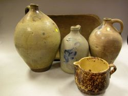 Three Stoneware Jugs, a Bennington Pitcher and a Wooden Trencher