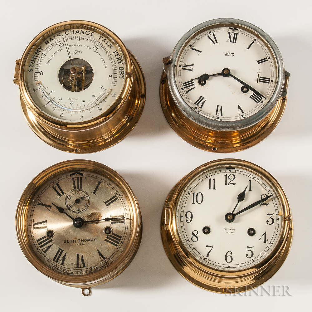 Three Brass-cased Ship's Clocks and a Barometer