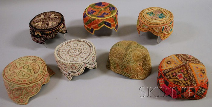 Seven Woven and Decorated Central Asian Caps.