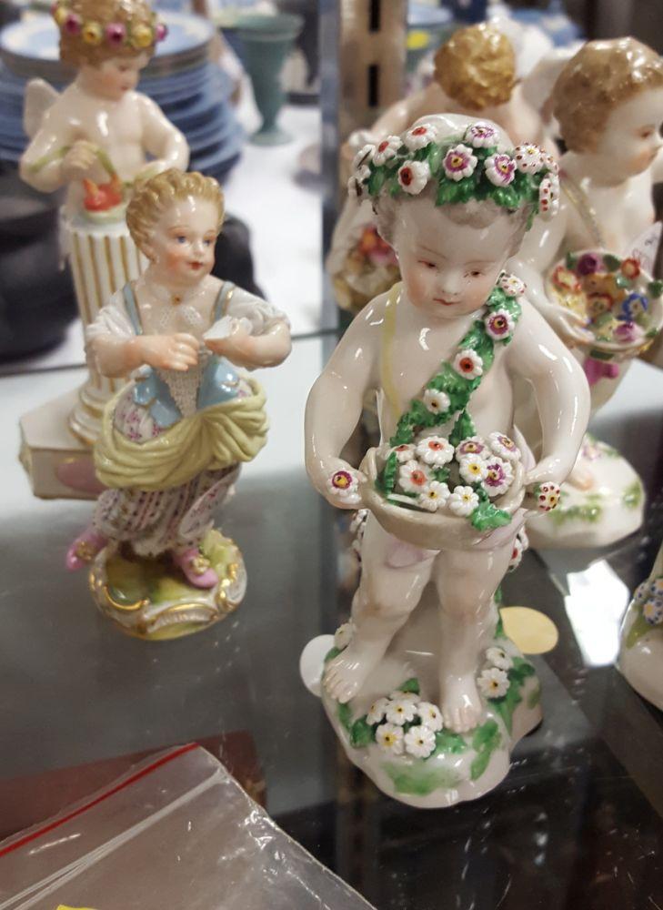 Seven Continental Porcelain Putti