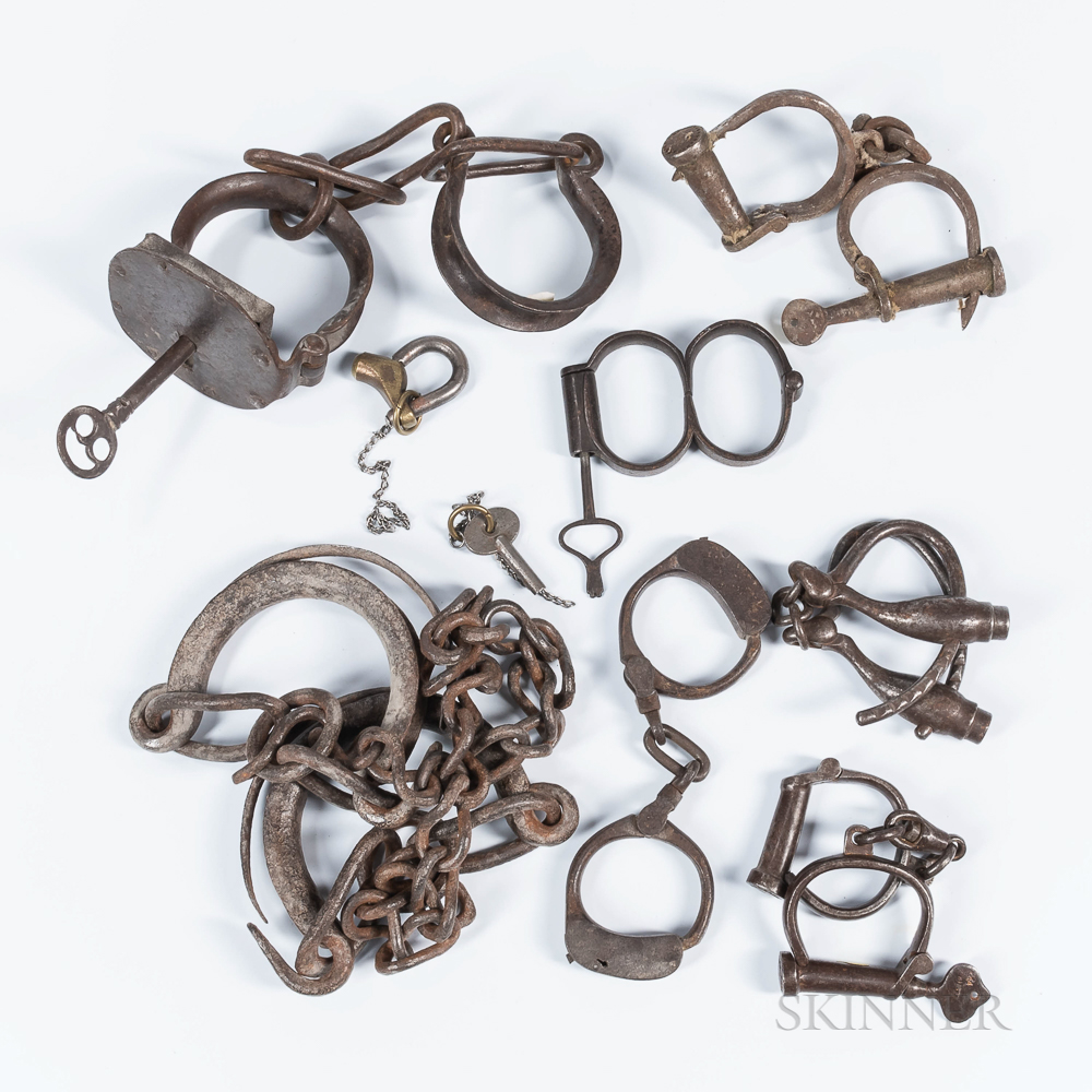Group of Iron Shackles and Handcuffs