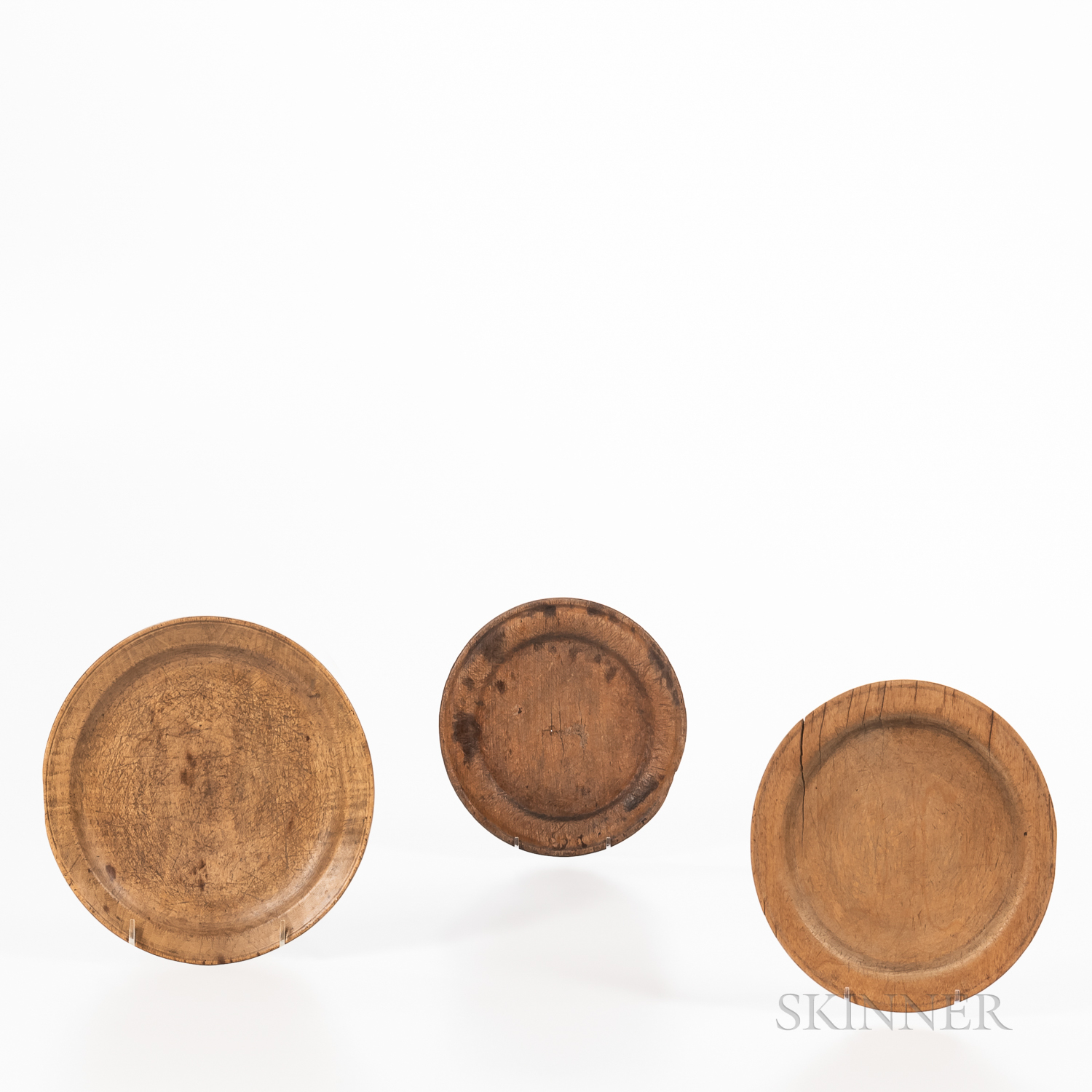 Three Turned Wooden Plates