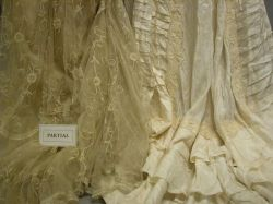 Nine Early 20th Century Ladys Lace, Embroidered and Beaded Ivory Silk and Satin Gowns and Dresses.