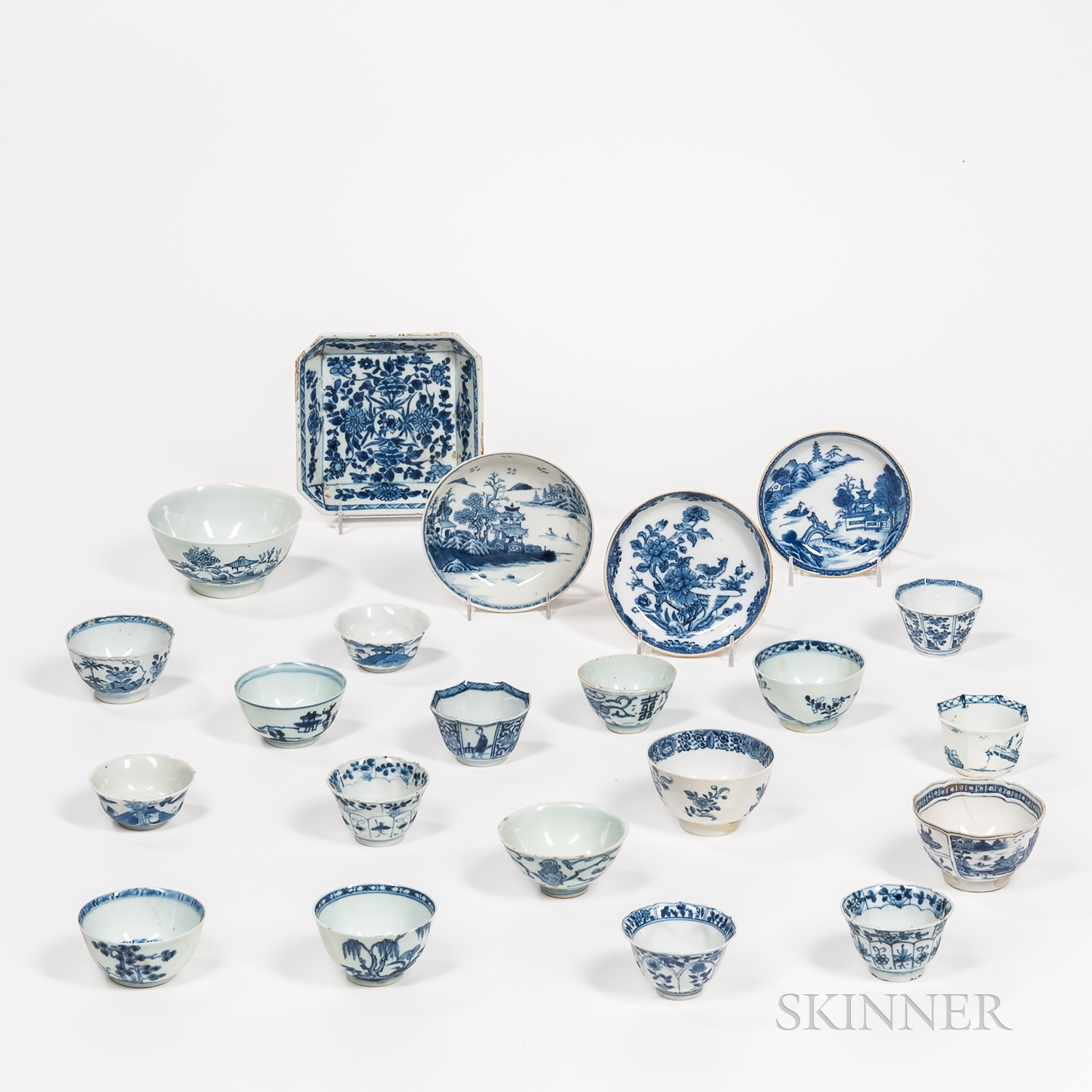 Twenty-two Blue and White Cups and Plates