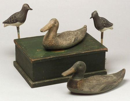 Two Painted Canvas Duck Decoys, a Pair of Painted Tin Bird Decoys, and a Green Painted Wooden Box.