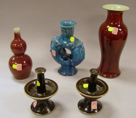 Two Chinese Sang de Boeuf Glazed Porcelain Vases, a Pair of Glazed Candlesticks, and a Chinese Blue Glaze Porcelain Vase.