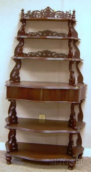 Victorian Rococo Revival Carved Walnut Serpentine Etagere.