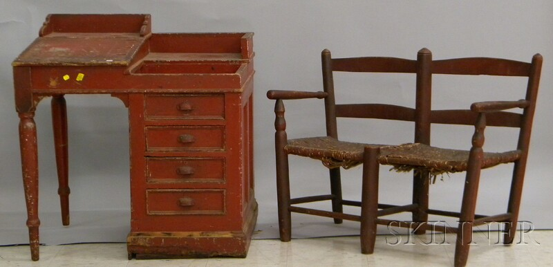 Red-painted Wood Lift-top Clerks Desk and a Red-painted Slat-back Wagon Seat with Woven Rush Seat.