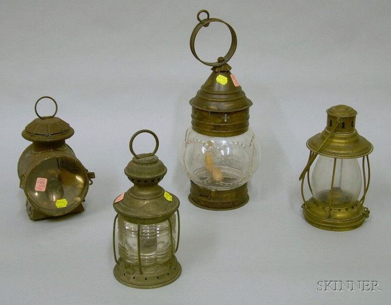 Four Glass and Metal Lanterns.