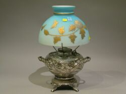 Silver Plated Juno Kerosene Lamp Base with Gilt Floral Decorated Cased Blue Satin Glass Shade.