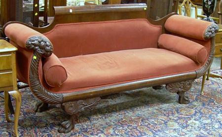 Classical Upholstered Carved Mahogany and Mahogany Veneer Sofa.