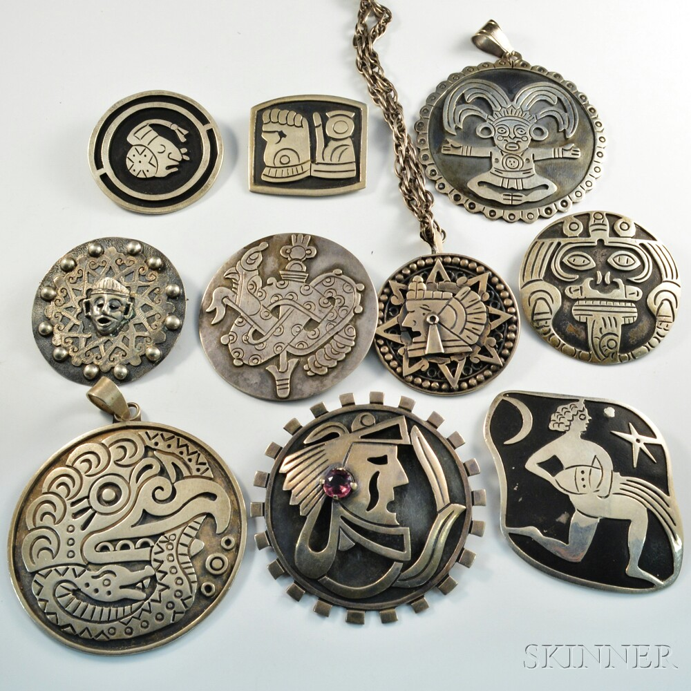 Ten mexican silver brooches and pendants sale number 2911t lot ten mexican silver brooches and pendants mozeypictures Choice Image