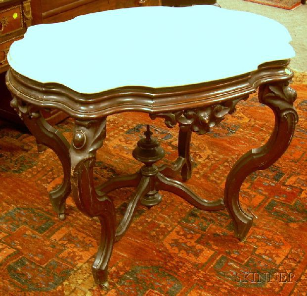 Victorian Rococo Revival White Marble Turtle-top Carved Walnut Center Table.