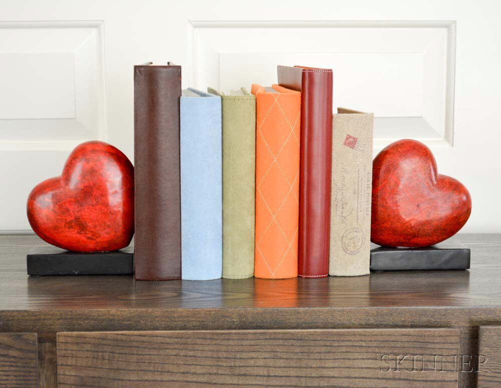 Pair of Carved Stone Heart-form Bookends with Four Photo Albums and a Bird Box.