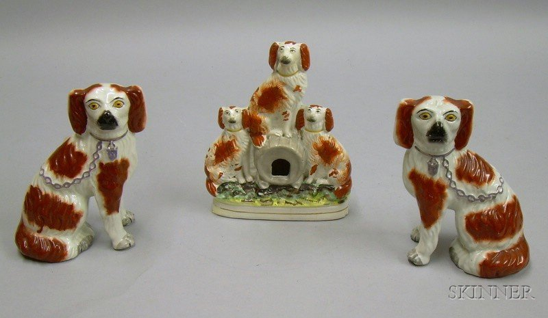Pair of Staffordshire Spaniels and a Spaniel Figural Group