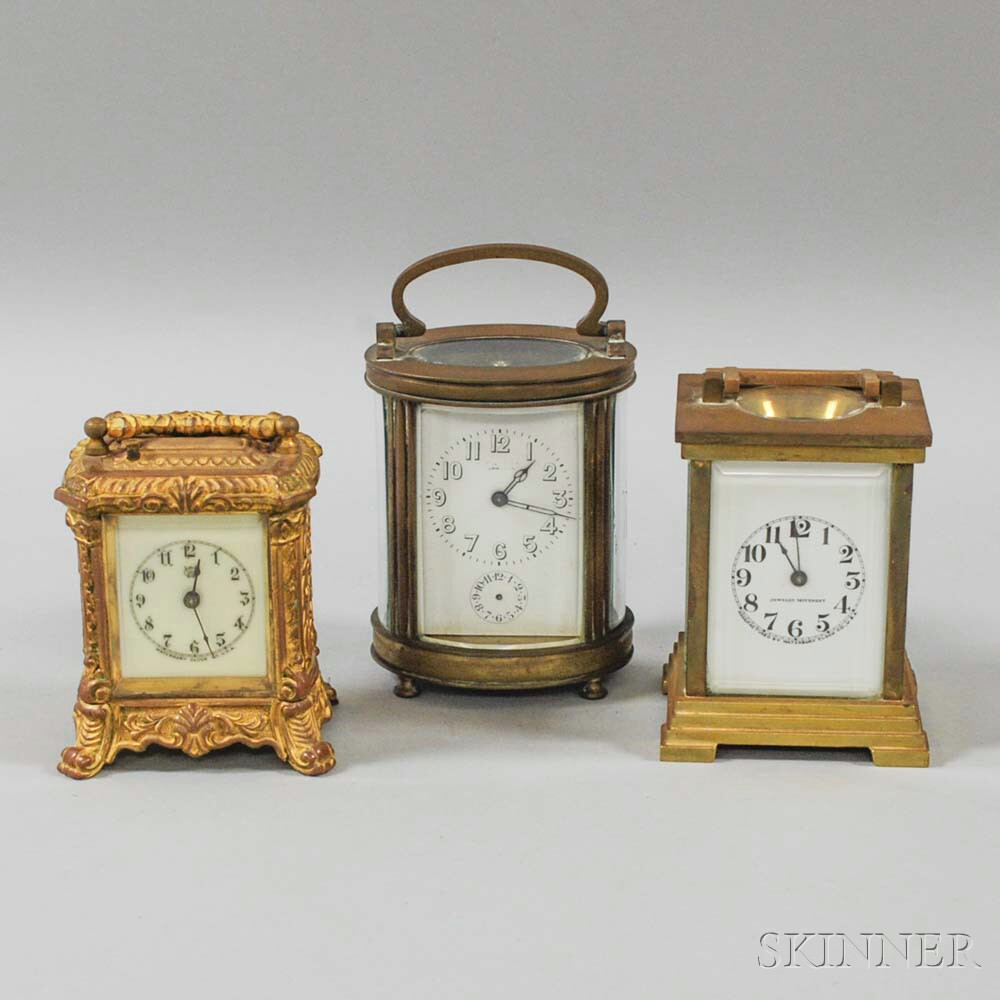 Two Waterbury Desk Clocks and a French Carriage Clock