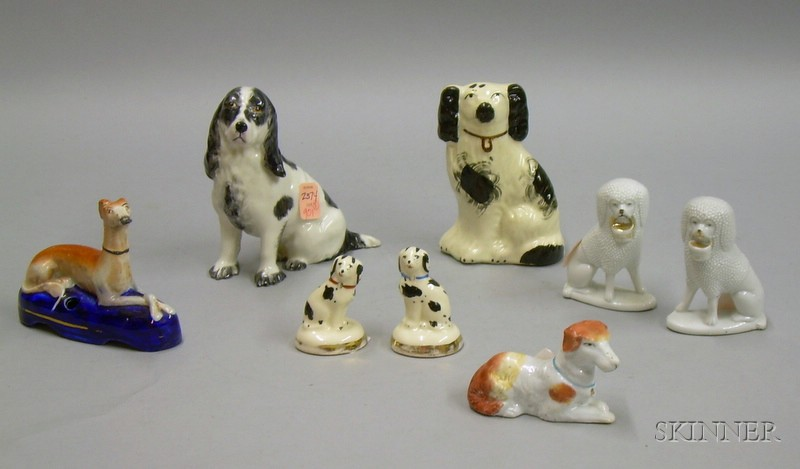 Eight Small Staffordshire and Staffordshire-type Ceramic Dogs