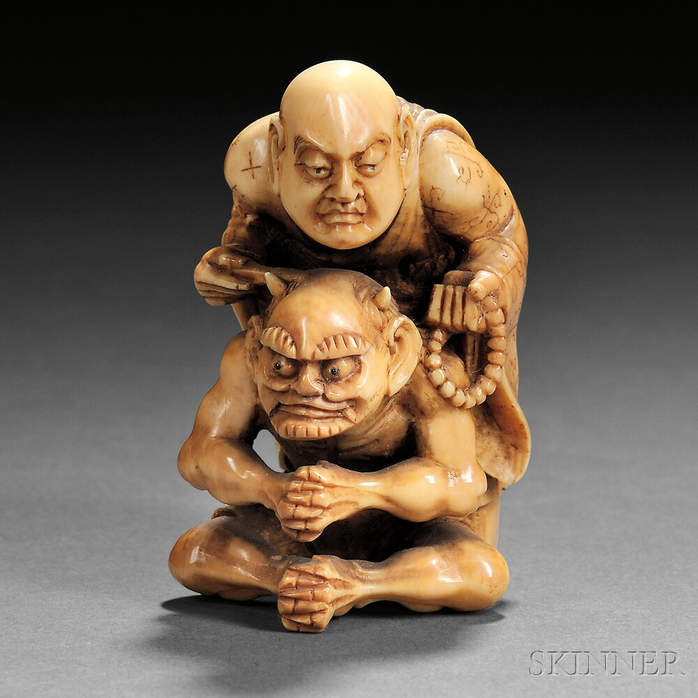 Ivory Carving of an Oni with a Priest