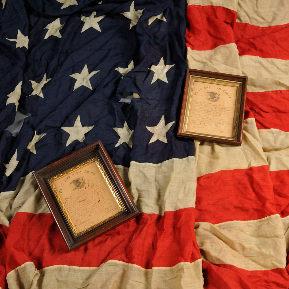Two Framed Civil War Discharges and American Flag