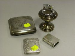 Four Small Sterling Silver Smoking Items.