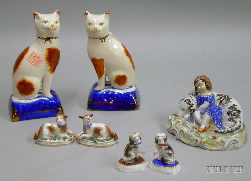 Pair of Staffordshire Seated Cats, a Sleeping Girl with Dog Figural Group, and Two Pairs of Porcelain Dogs....