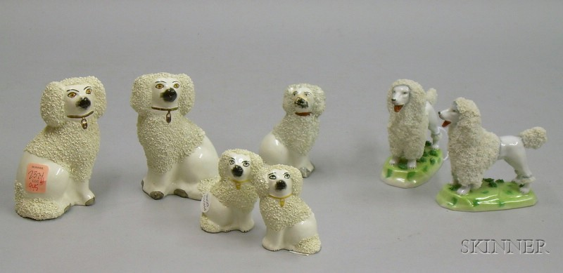 Seven Staffordshire and Staffordshire-type Ceramic Dog Figures