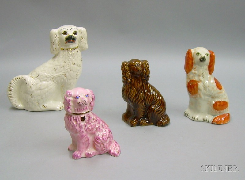 Four English Staffordshire Seated Dogs