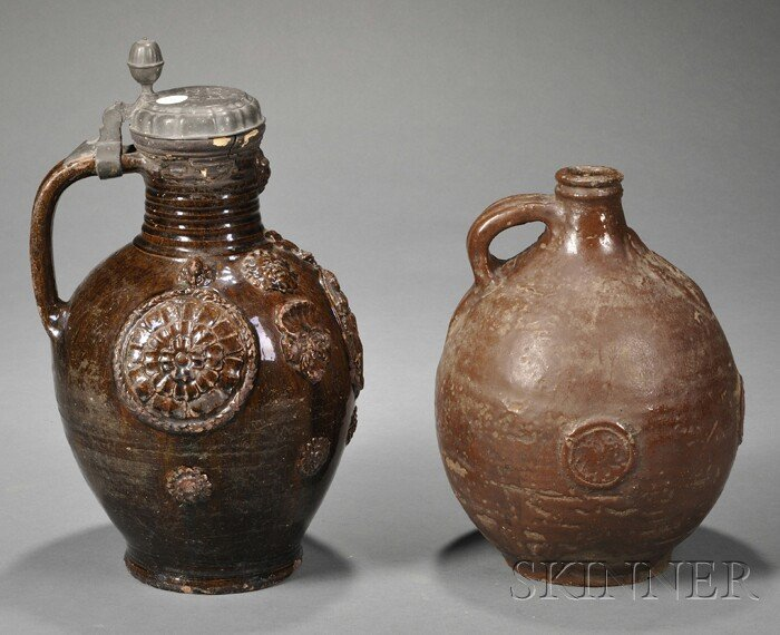 Two Brown Iron Glazed Jugs