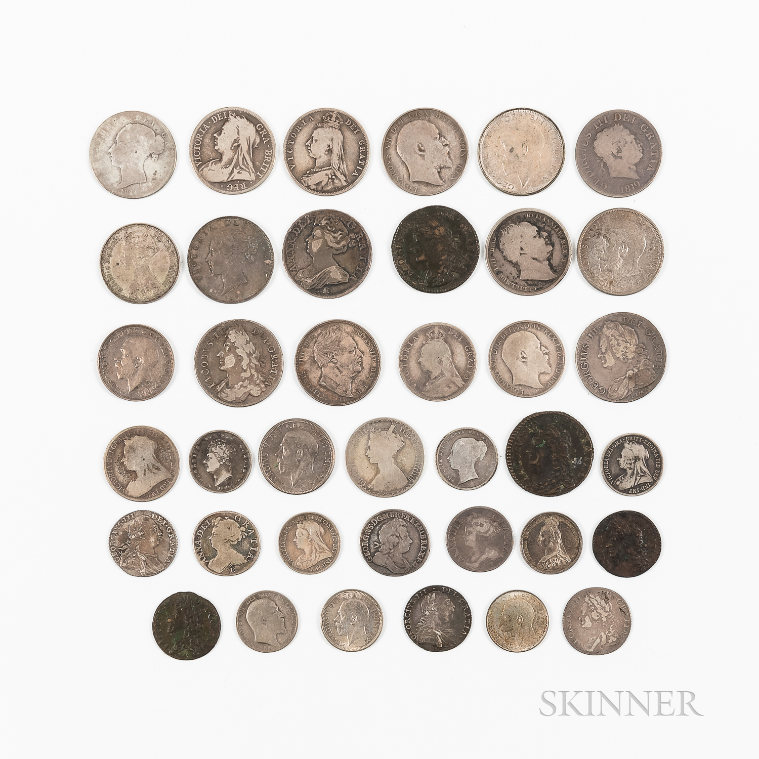 Group of British Half Crowns, Florin, and Shillings