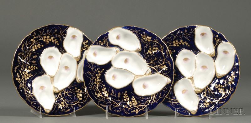 Set of Three Gilt and Cobalt Decorated Porcelain Oyster Plates.